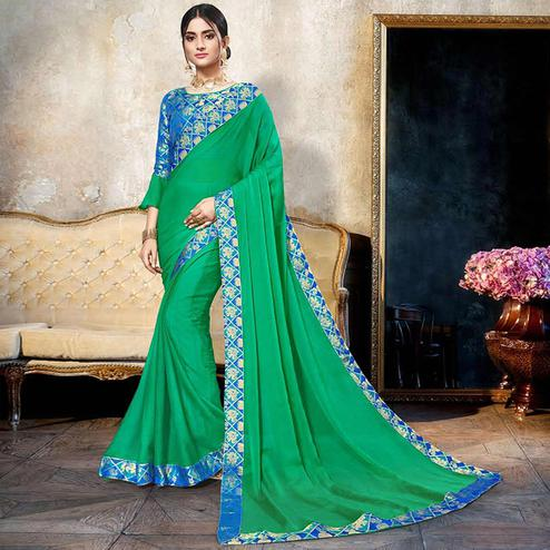 Mesmeric Green Colored Partywear Printed Heavy Georgette Saree With Lace Border