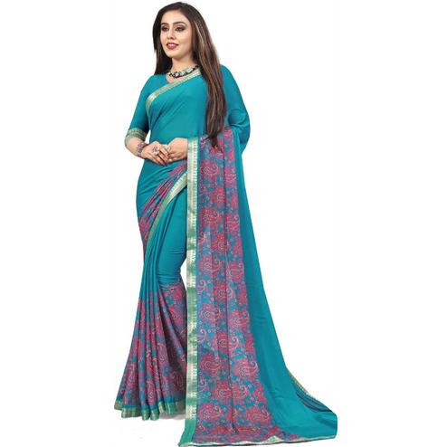 Adorning Sky Blue Colored Partywear Printed Heavy Georgette Saree With Lace Border