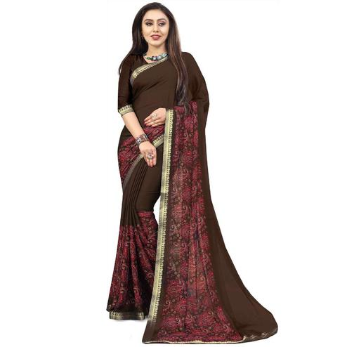 Appealing Brown Colored Partywear Printed Heavy Georgette Saree With Lace Border