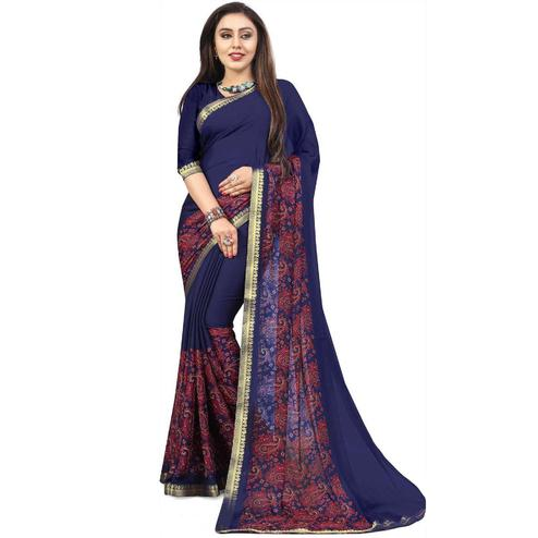 Capricious Navy Blue Colored Partywear Printed Heavy Georgette Saree With Lace Border