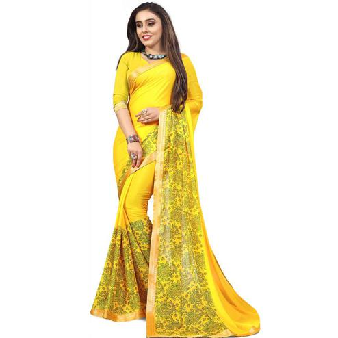 Groovy Yellow Colored Partywear Printed Heavy Georgette Saree With Lace Border