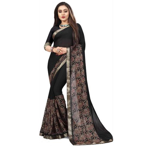 Innovative Black Colored Partywear Printed Heavy Georgette Saree With Lace Border