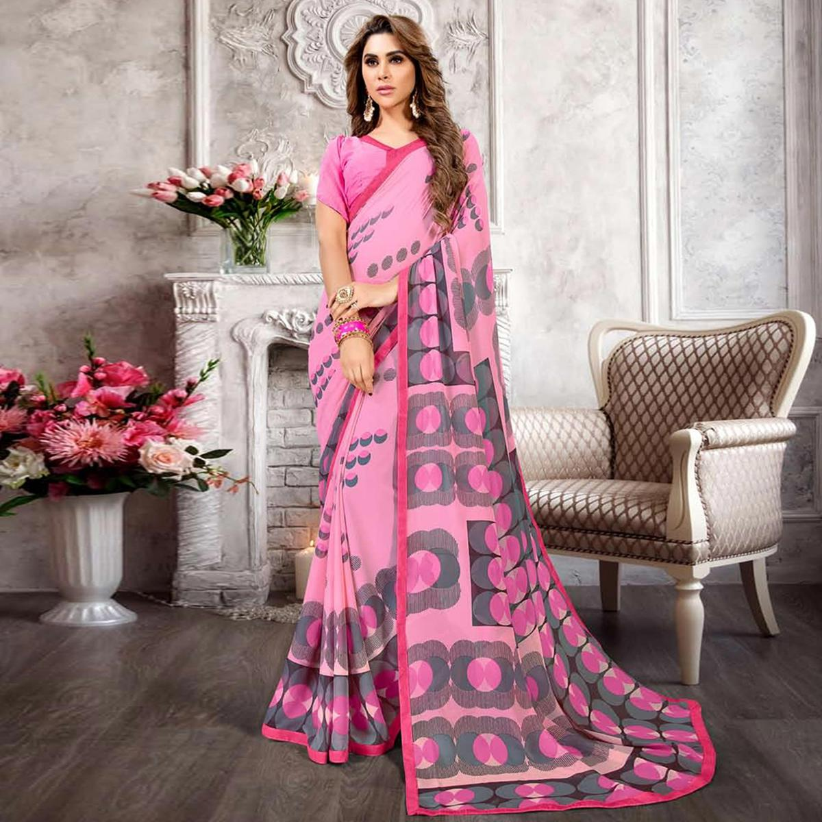 Imposing Pink Colored Casual Printed Heavy Georgette Saree With Lace Border