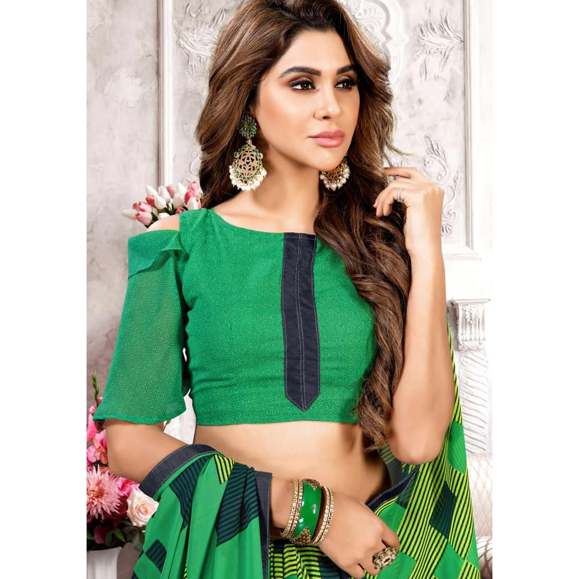 Pleasance Green Colored Casual Printed Heavy Georgette Saree With Lace Border