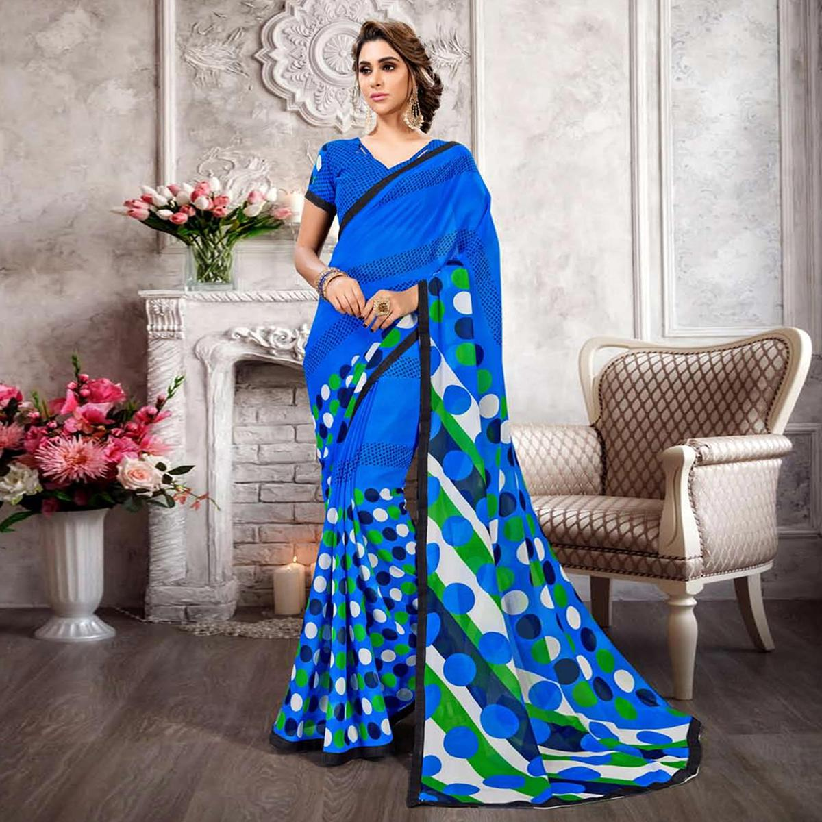 Pretty Blue Colored Casual Printed Heavy Georgette Saree With Lace Border