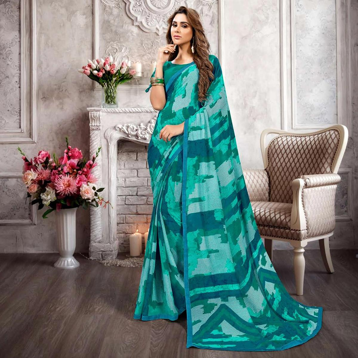 Staring Aqua Green Colored Casual Printed Heavy Georgette Saree With Lace Border
