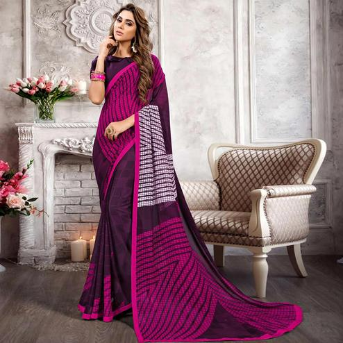 Stunning Dark Purple Colored Casual Printed Heavy Georgette Saree With Lace Border