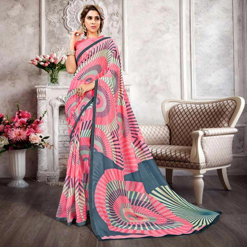 Surpassing Light Pink Colored Casual Printed Heavy Georgette Saree With Lace Border