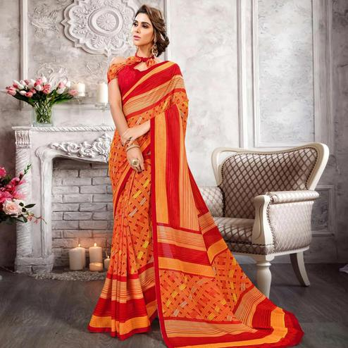 Intricate Orange Colored Casual Printed Heavy Georgette Saree With Lace Border