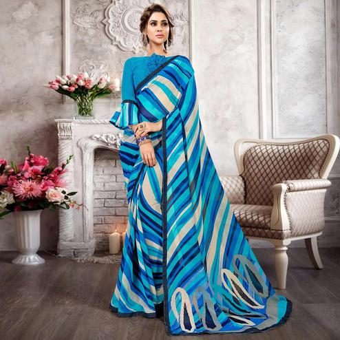Arresting Blue Colored Casual Printed Heavy Georgette Saree With Lace Border