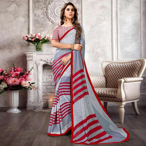 Desirable Gray Colored Casual Printed Heavy Georgette Saree With Lace Border