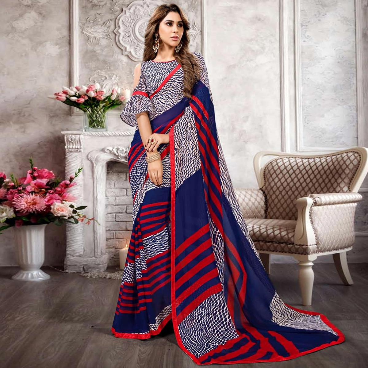 Flattering White-Blue Colored Casual Printed Heavy Georgette Saree With Lace Border