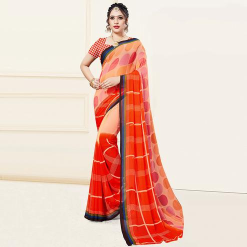 Imposing Orange-Peach Colored Casual Printed Georgette Saree
