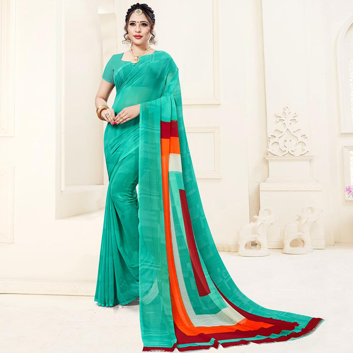 Majesty Turquoise Green Colored Casual Printed Georgette Saree