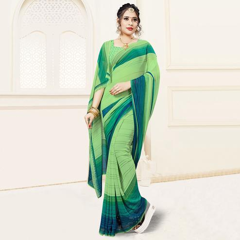Pretty Green Colored Casual Printed Georgette Saree