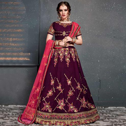 Stunning Purple Colored Partywear Embroidered Tapeta Silk Lehenga Choli