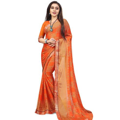 Glowing Orange Colored Casual Printed Chiffon Saree