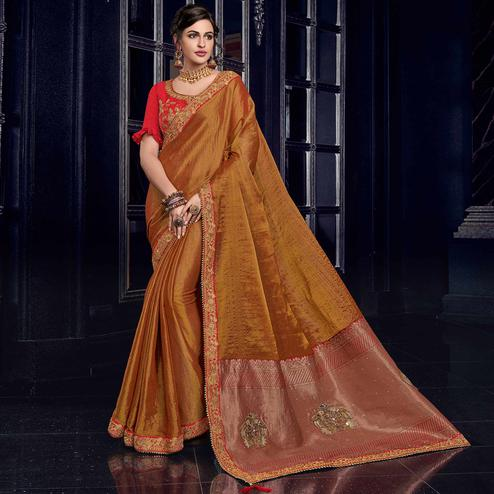 Capricious Rust Orange Colored Embroidered Party Wear Silk Saree