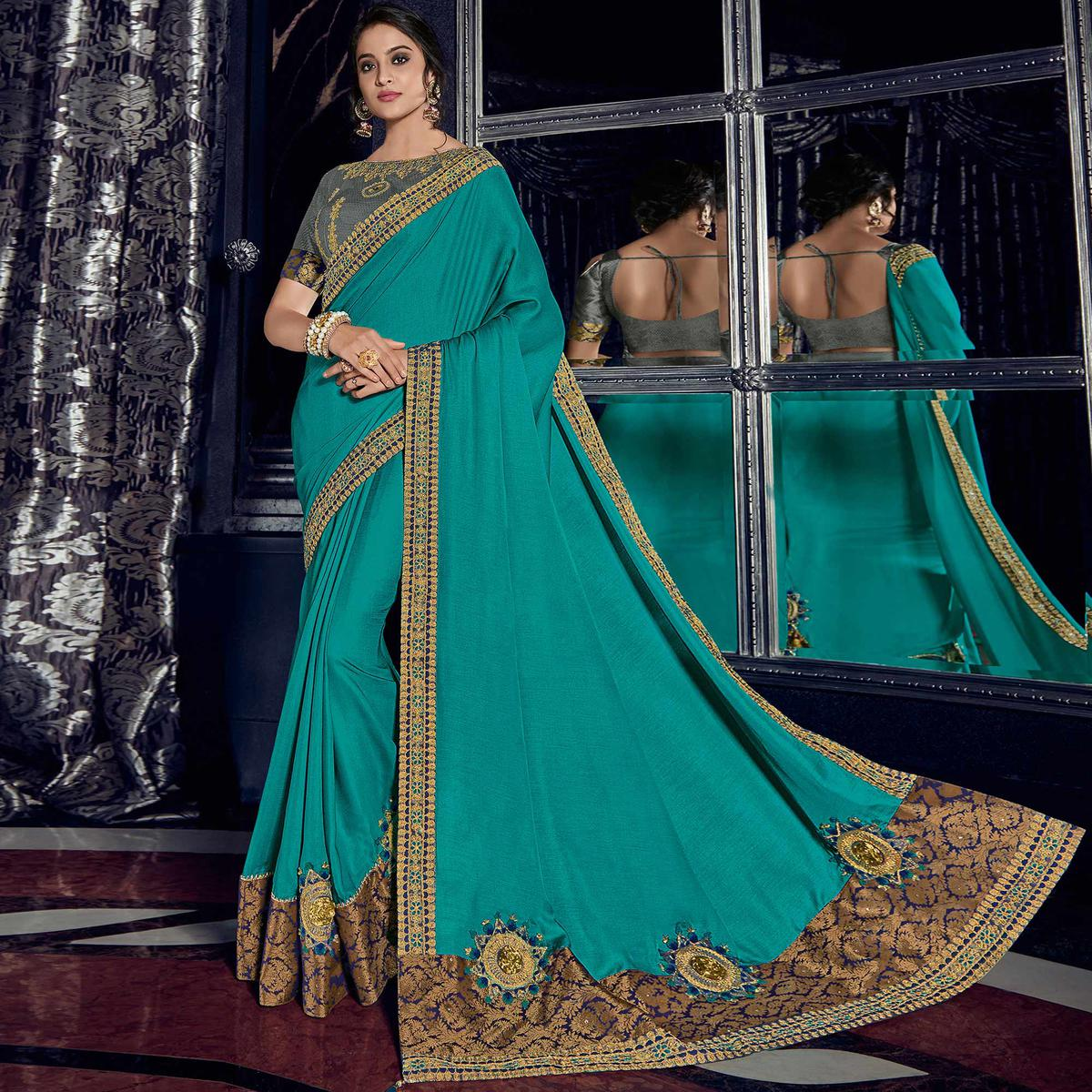 Groovy Blue Colored Embroidered Party Wear Raw Silk Saree