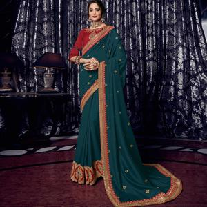 Innovative Peacock Green Colored Embroidered Party Wear Silk Saree