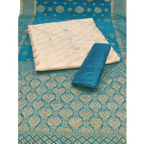 Glowing Cream-Rama Blue Colored Party Wear Woven Jacquard Dress Material