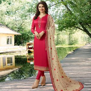Attractive Deep Pink Colored Partywear Embroidered Georgette Satin Suit