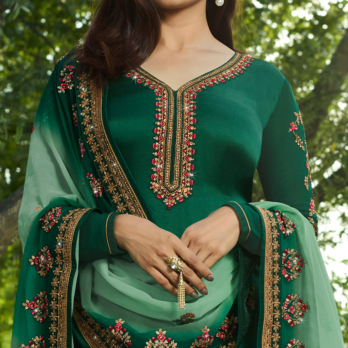 Staring Green Colored Partywear Embroidered Georgette Satin Suit