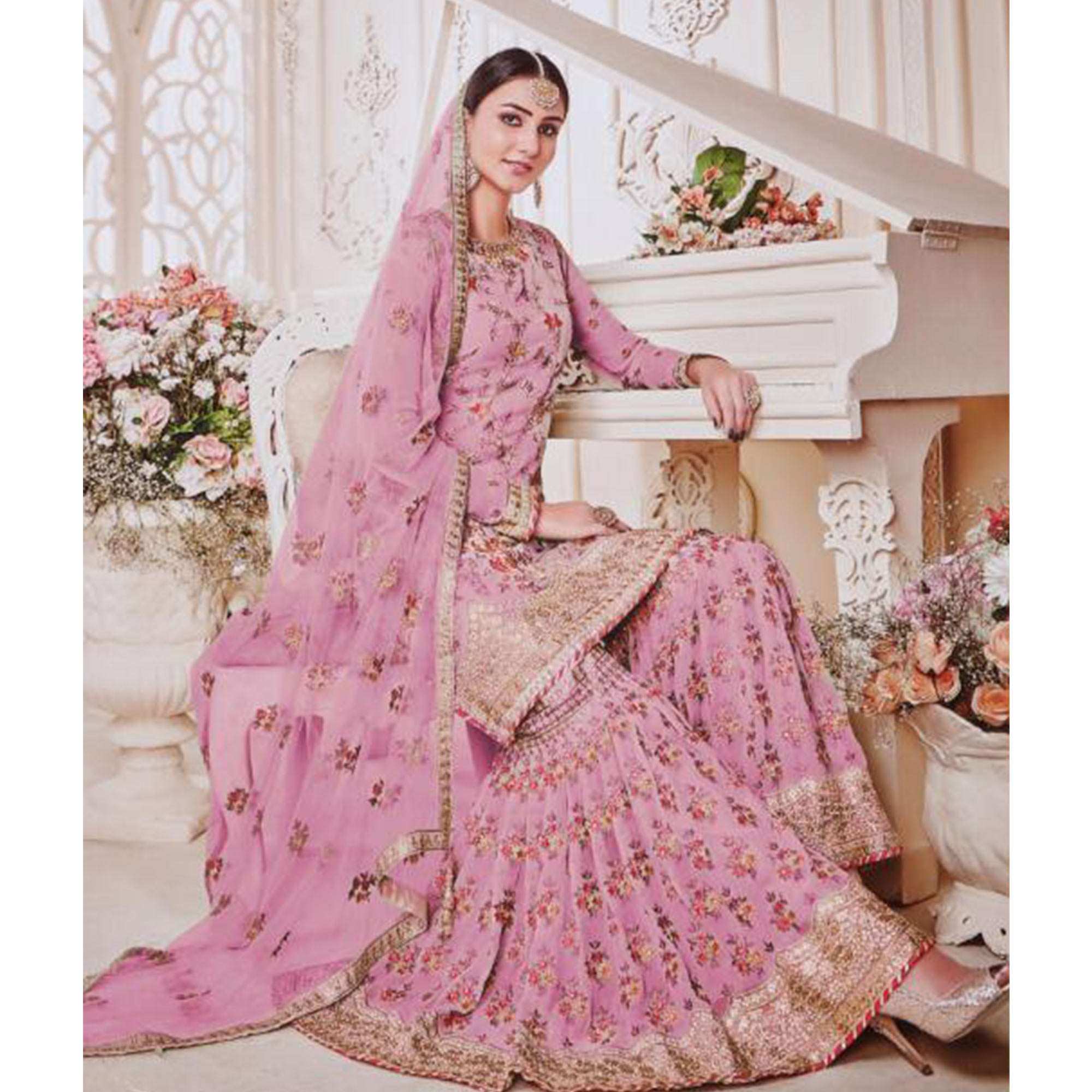 Glowing Pink Colored Party Wear Embroidered Faux Georgette Palazzo Suit