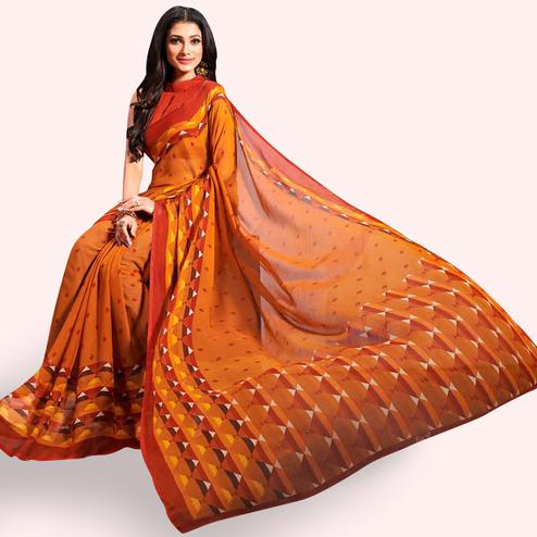Charming Orange Colored Casual Printed Chiffon Saree