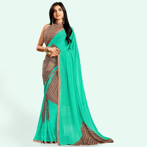 Entrancing Turquoise Green Colored Casual Printed Faux Georgette Saree