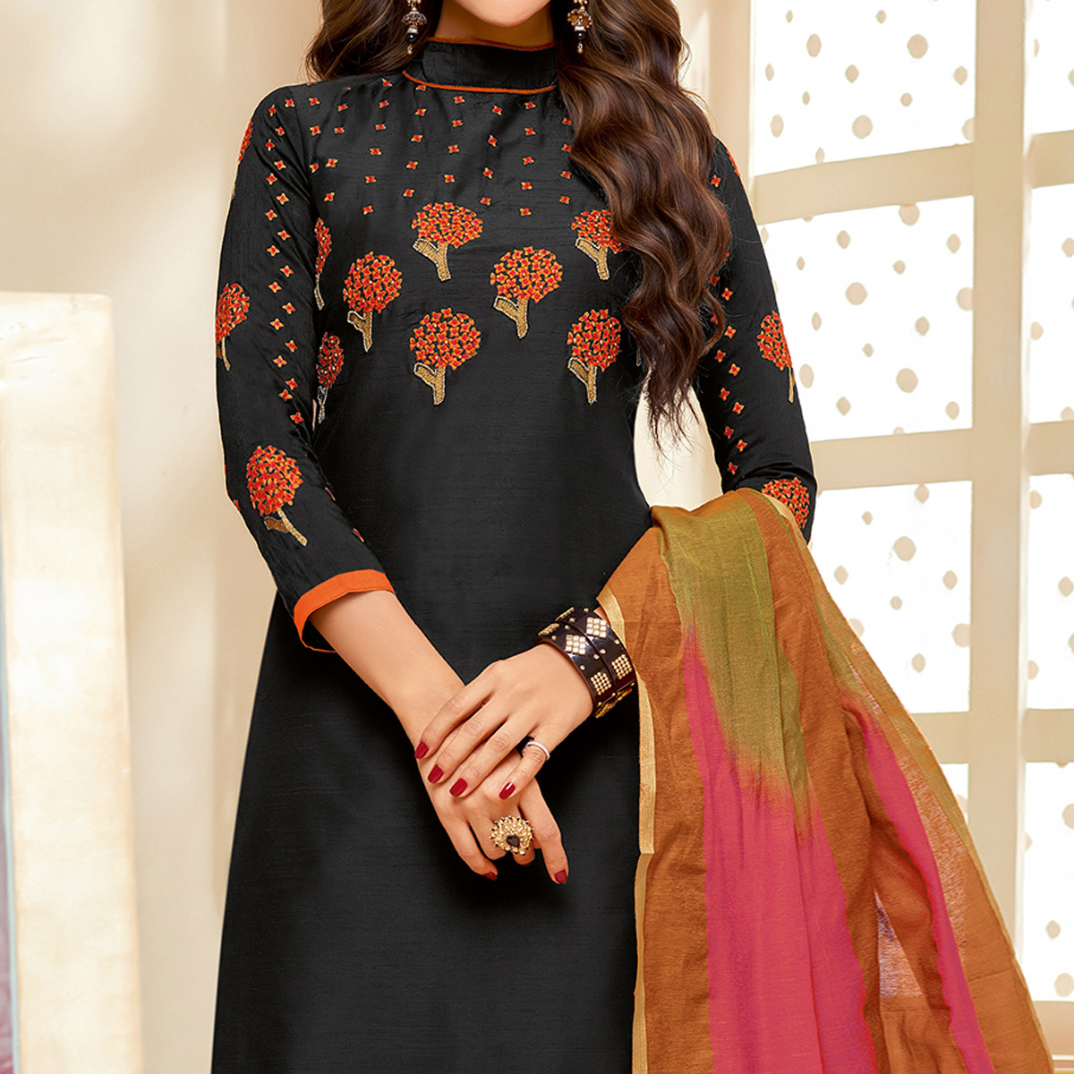 Glowing Black Colored Embroidered Party Wear Cotton Silk Dress Material