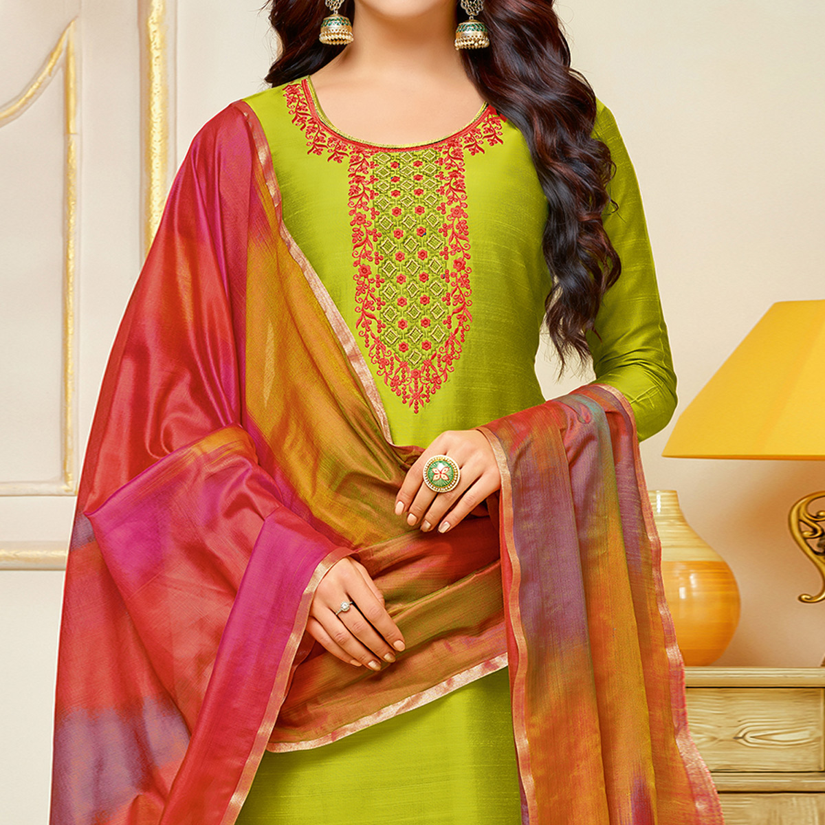 Demanding Green Colored Embroidered Party Wear Cotton Silk Dress Material