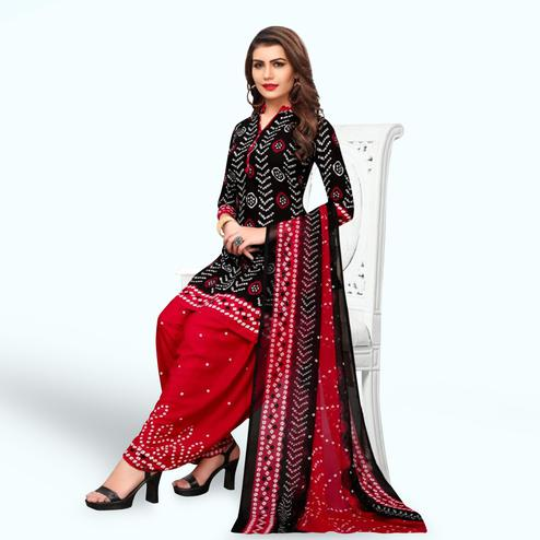 Demanding Black Colored Casual Wear Printed Crepe Patiala Suit
