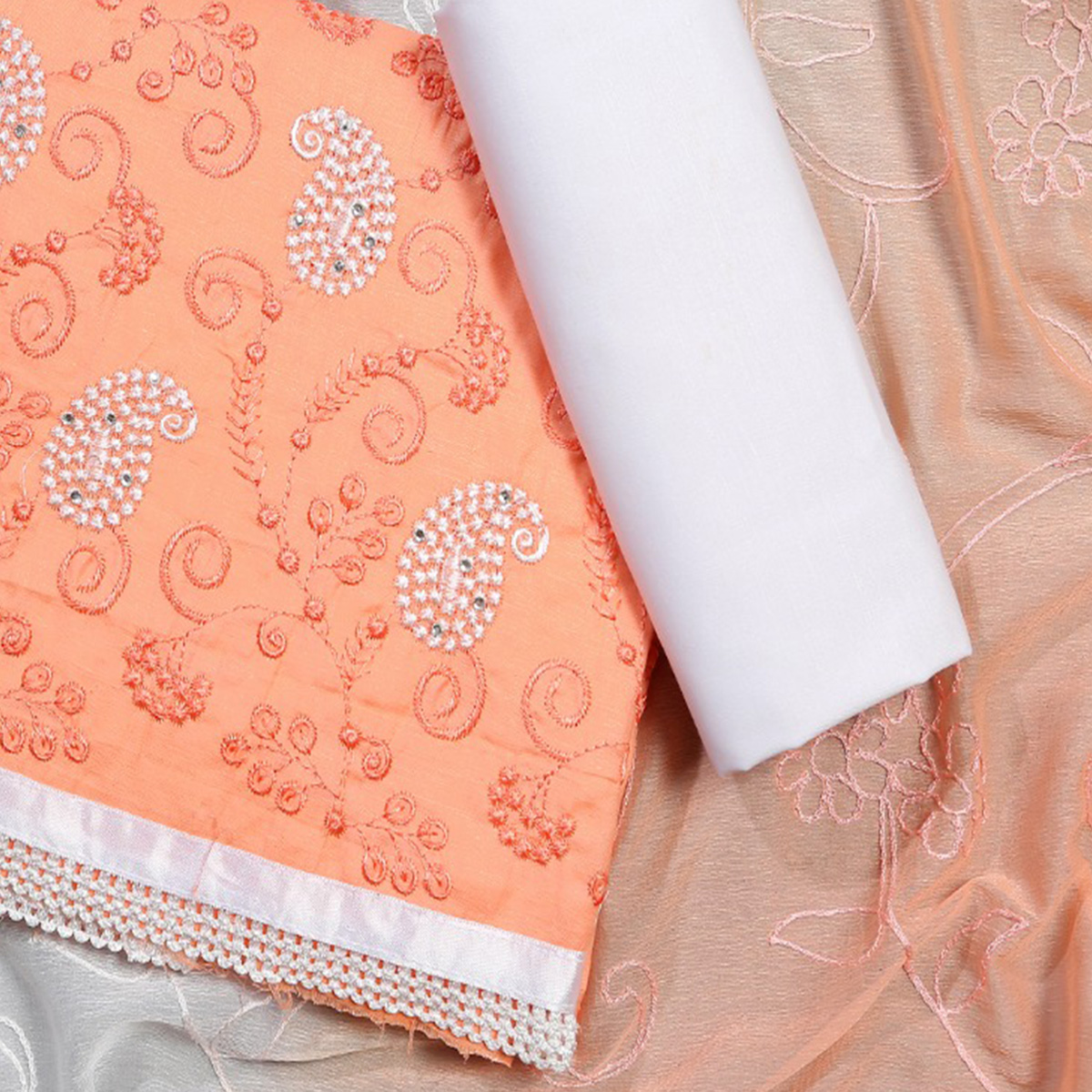 Sophisticated Peach Colored Partywear Embroidered Modal Dress Material