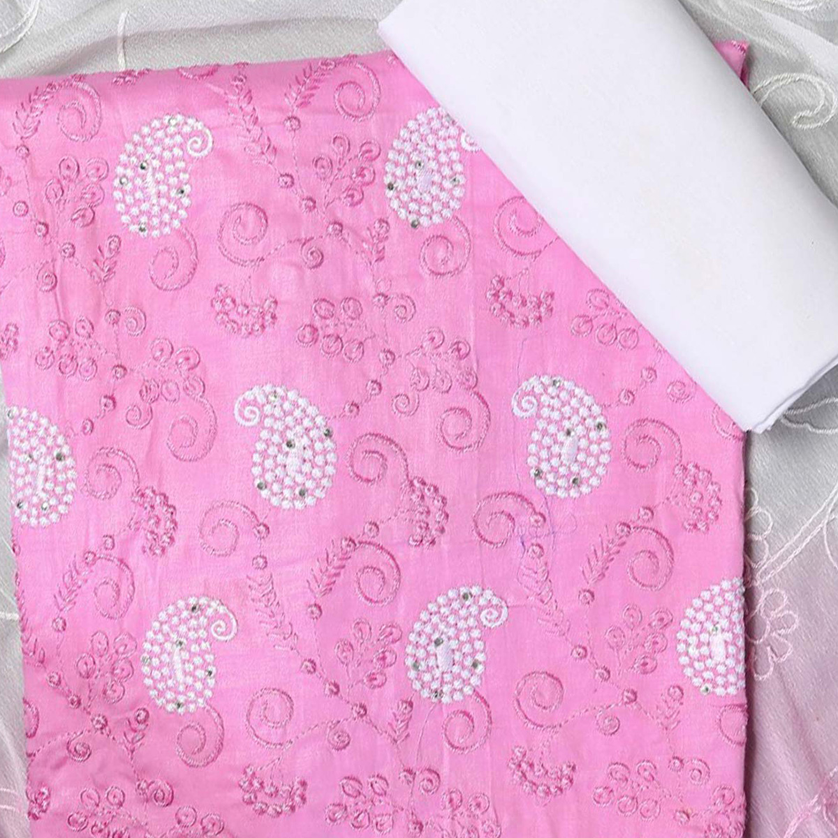 Pleasant Pink Colored Partywear Embroidered Modal Dress Material