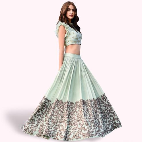 Stunning Pastel Aqua Blue Colored Partywear Embroidered Satin Lehenga Choli