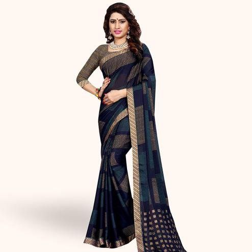 Glorious Navy Blue Colored Casual Printed Georgette Saree