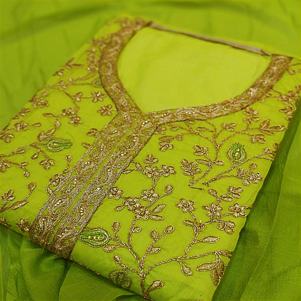 Delightful Green Colored Party Wear Embroidered Modal Silk Dress Material