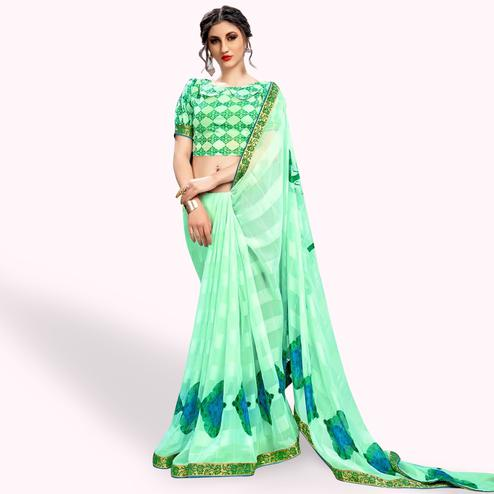 Gorgeous Aqua Green Colored Casual Wear Printed Georgette Saree