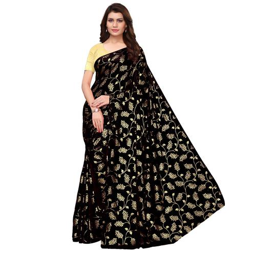 Blissful Black Colored Party Wear Foil Printed Georgette Saree