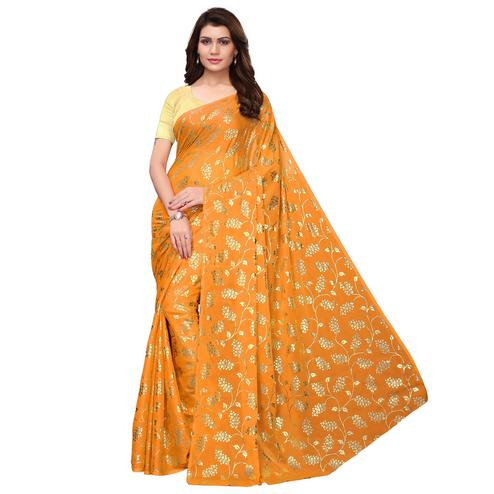 Engrossing Yellow Colored Party Wear Foil Printed Georgette Saree