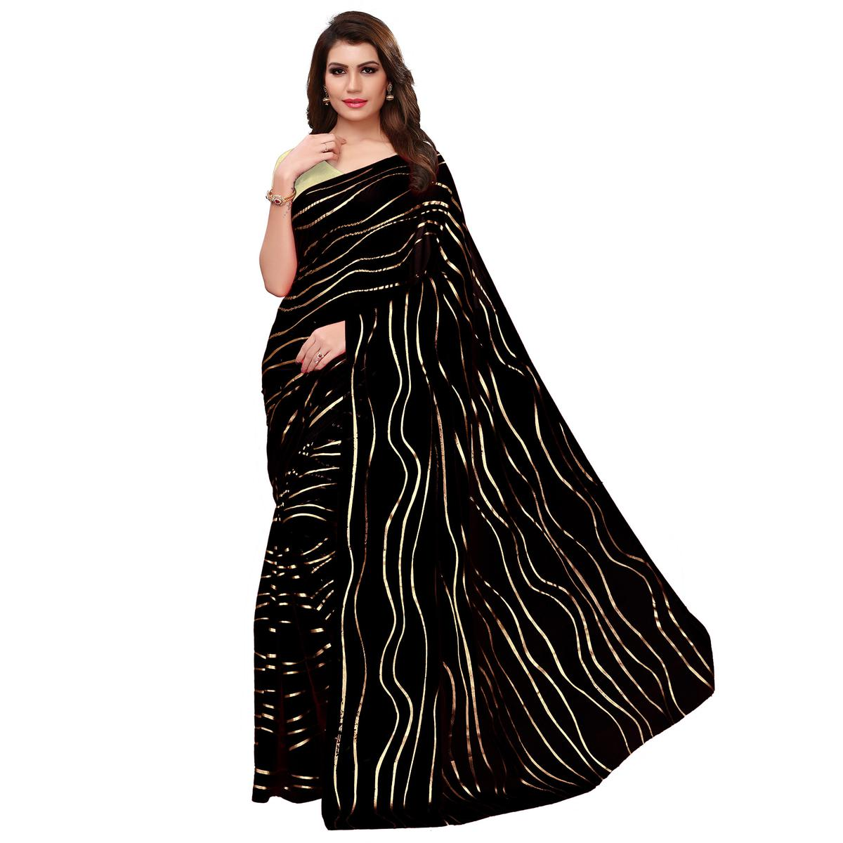Exotic Black Colored Party Wear Foil Printed Georgette Saree
