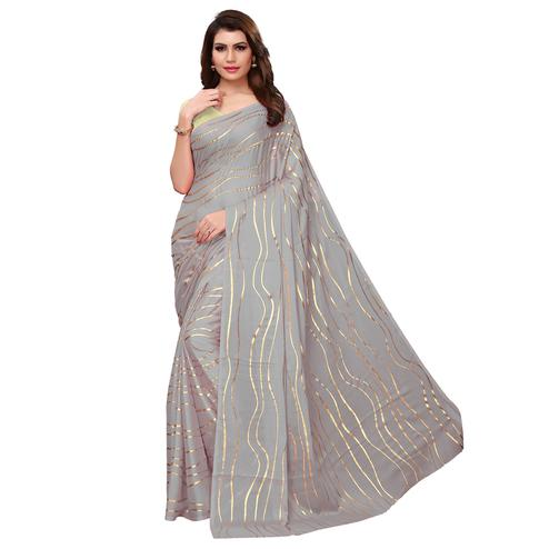 Eye-catching Grey Colored Party Wear Foil Printed Georgette Saree
