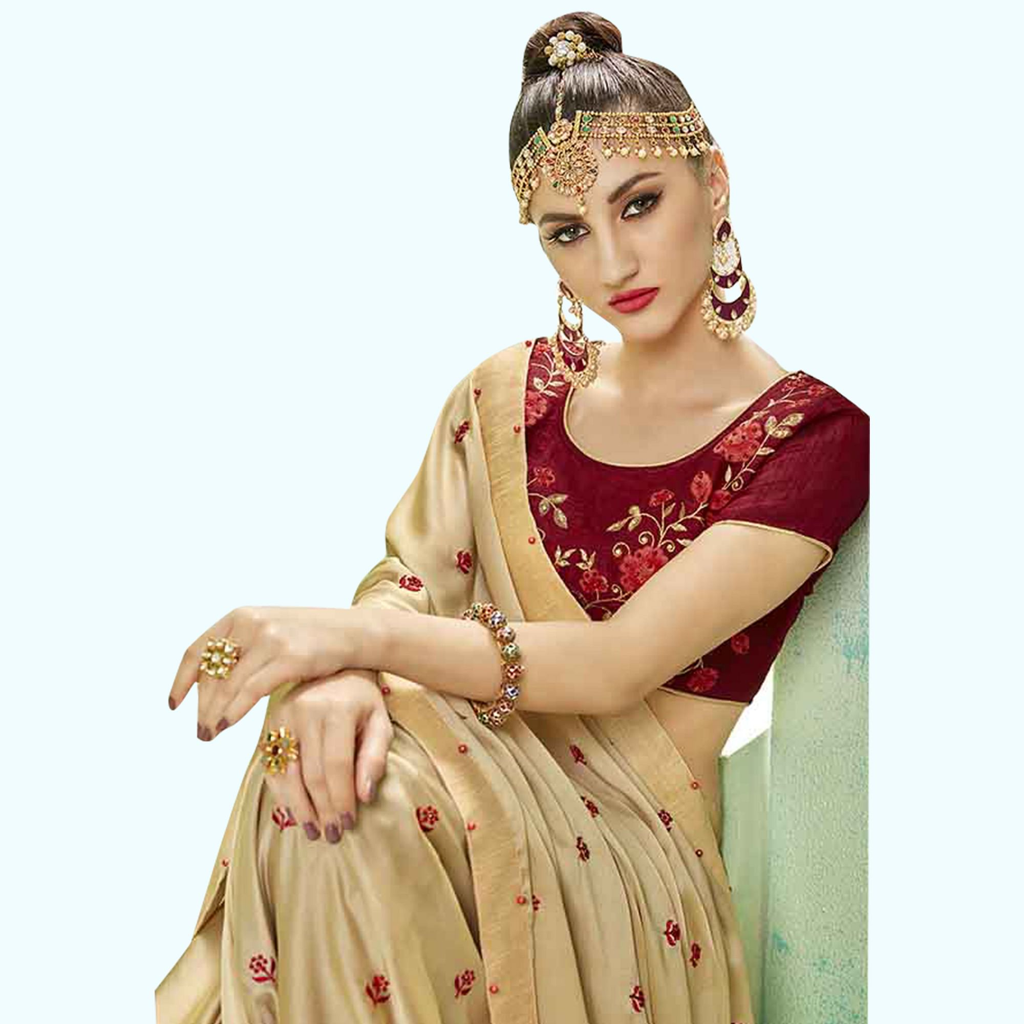 Alluring Beige Colored Party Wear Embroidered Georgette Saree