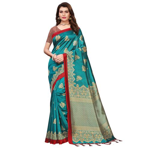 Engrossing Teal Blue Colored Festive Wear Printed Art Silk Saree With Tassels