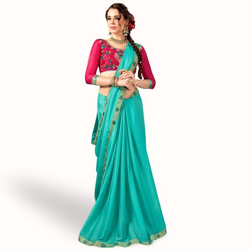 Refreshing Turquoise Blue Colored Party Wear Embroidered Georgette Saree