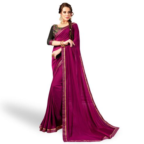 Hypnotic Dark Magenta Colored Party Wear Embroidered Georgette Saree