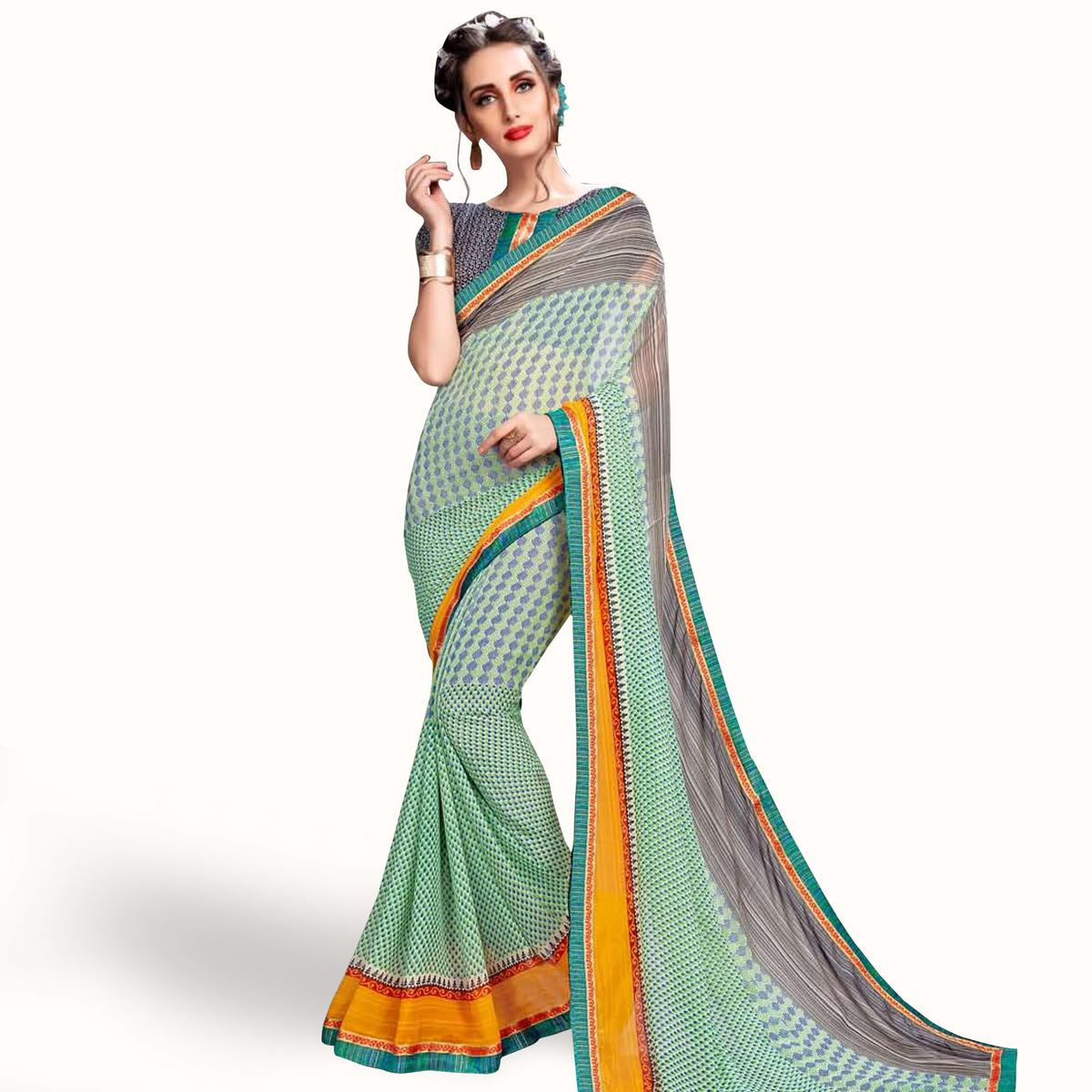 Adorning Mint Green Colored Casual Wear Printed Georgette Saree
