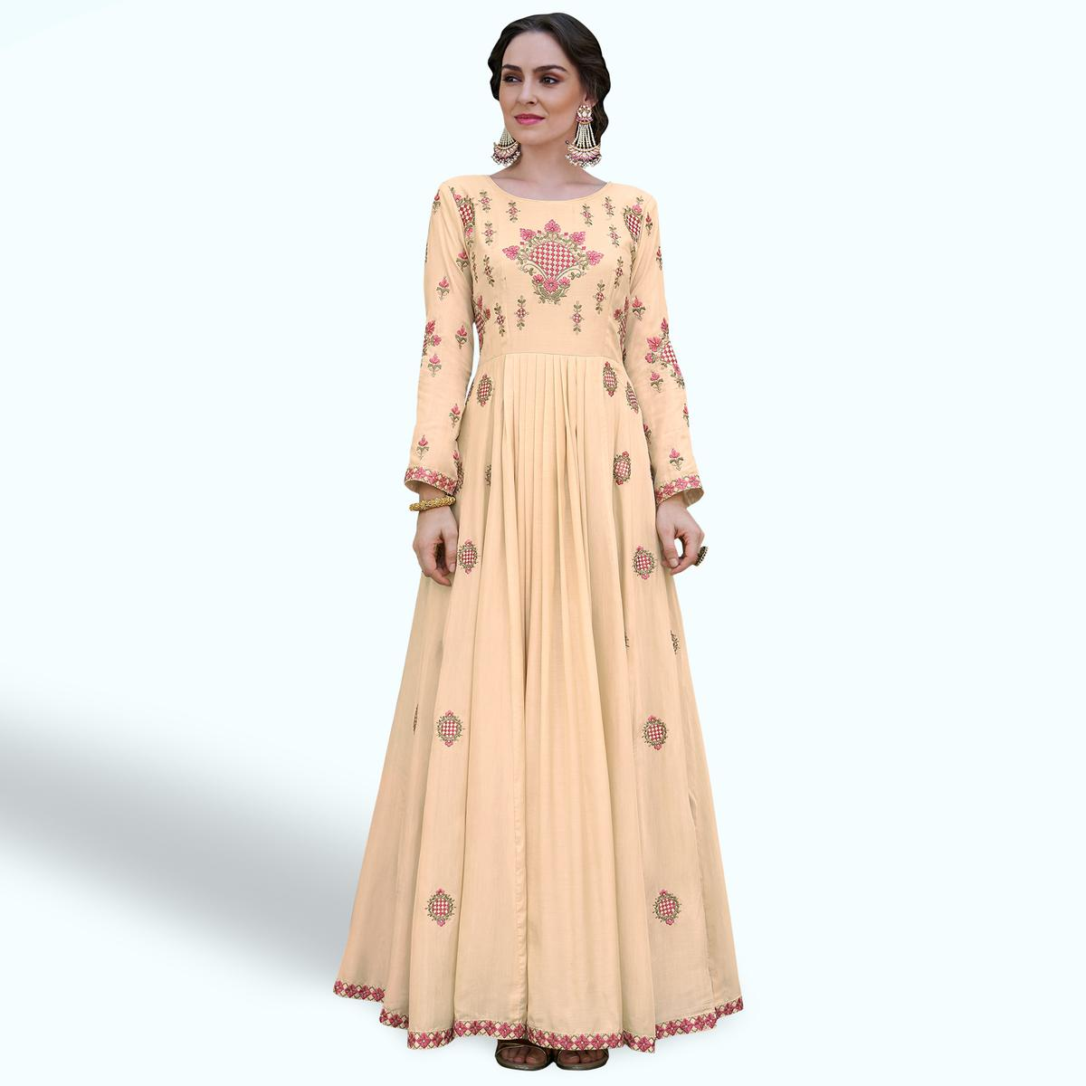 Gleaming Cream Colored Party Wear Embroidered Heavy Rayon Gown
