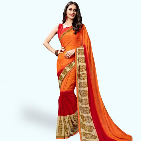 Delightful Orange Colored Casual Printed Georgette Saree